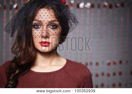 Portrait of beautiful young woman face. Isolated on dark background