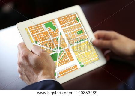 Businessman holding tablet with map gps navigation application
