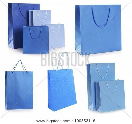 Blue paper shopping bags isolated on white