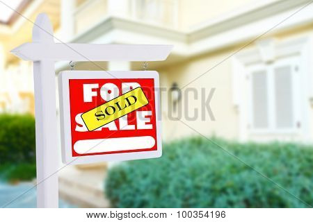 Real estate sign in front of new house for sale