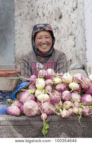 Smiling Tibetan Woman Sells Vegetables At The Market In Leh, Ladakh. India