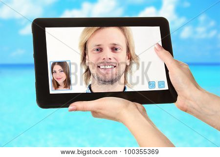 Young couple talking to each other via online video chat