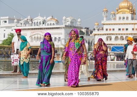 Sikhs And Indian People Visiting The Golden Temple In Amritsar, Punjab, India.