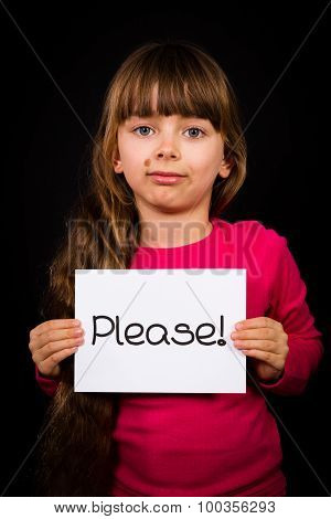 Child Holding Please Sign