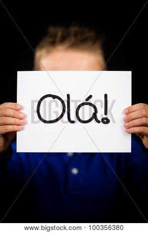 Child Holding Sign With Portuguese Word Ola - Hello