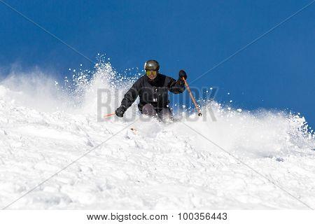 Skier Skiing Off Piste In Powder Snow
