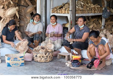 Indonesian Women Are Making Wooden Souvenirs For Tourist .ubud, Bali. Indonesia