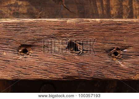 Old grungy wood part with old nail holes (nails pulled out).