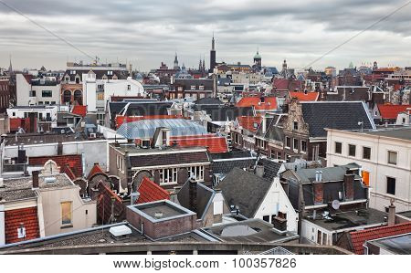 Roofs of Amsterdam,  Netherlands. Top view of old-time houses in Amsterdam, Netherlands. Toned image