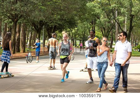 BRASILIA, BRAZIL - CIRCA JAN 2015: People enjoy a hot day in Ibirapuera Park in Sao Paulo, Brazil.