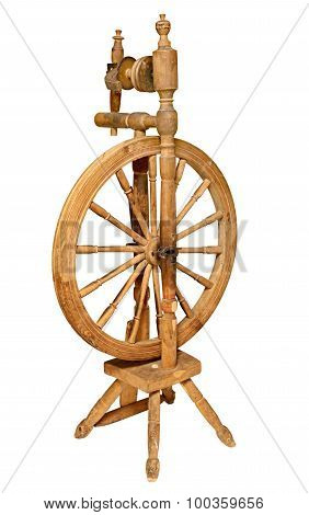 Old Wooden spinning Wheel isolated on white background.