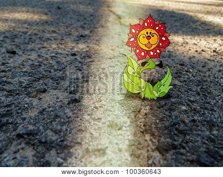 Combination of drawing and photography - fabulous flower on the asphalt