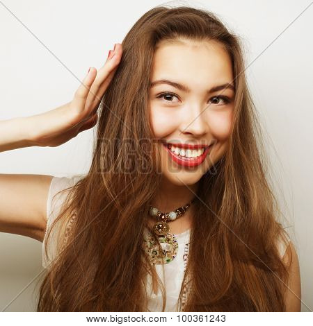 Beautiful young happy woman. Studio shot.