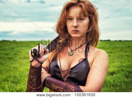 Girl Warrior In The Field. Portrait