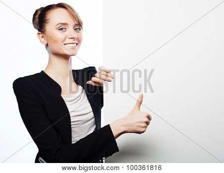 Happy smiling young business woman showing blank signboard, over white  background