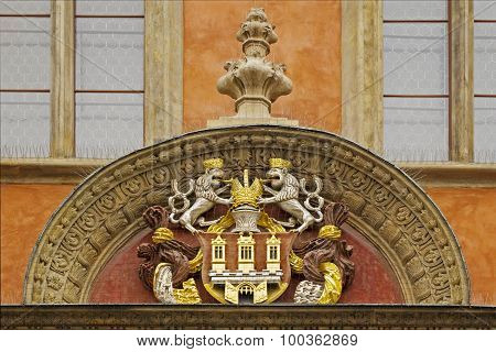 The emblem of the Prague above the entrance to the touristic center at the square