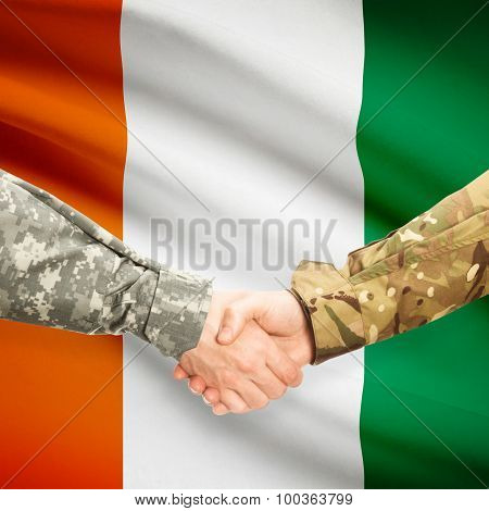 Men In Uniform Shaking Hands With Flag On Background - Ivory Coast