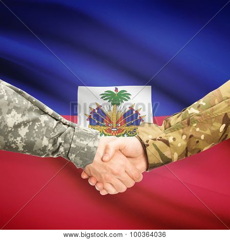 Men In Uniform Shaking Hands With Flag On Background - Haiti