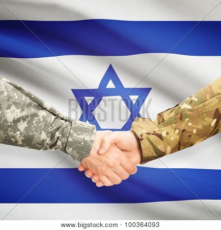 Men In Uniform Shaking Hands With Flag On Background - Israel