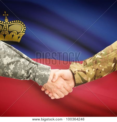 Men In Uniform Shaking Hands With Flag On Background - Liechtenstein