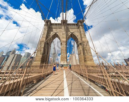 NEW YORK,USA- AUGUST 20,2015 : Tourists at the Brooklyn Bridge on a beautiful summer day
