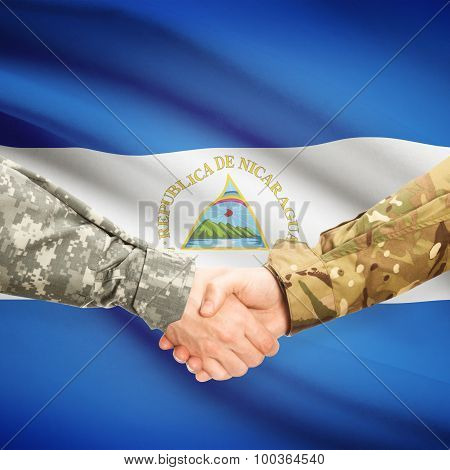 Men In Uniform Shaking Hands With Flag On Background - Nicaragua