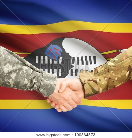 Men In Uniform Shaking Hands With Flag On Background - Swaziland
