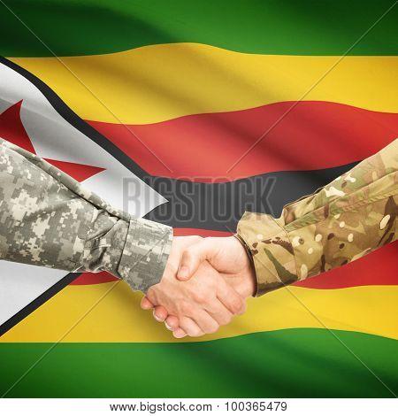 Men In Uniform Shaking Hands With Flag On Background - Zimbabwe