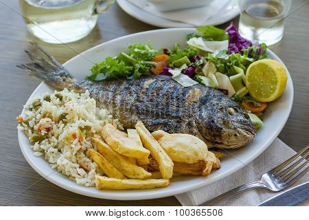 Bream With Potato, Rice And Salad