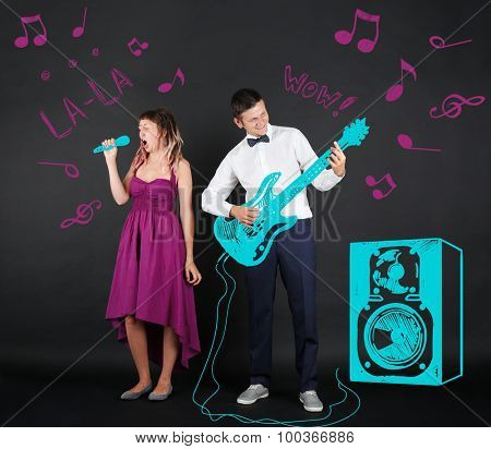 Musical young couple, on black background