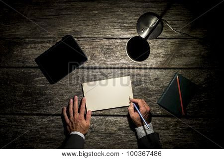 Businessman Working Late At His Desk