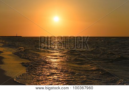 Stunning Golden Sunset At The Beach With Sea Waves