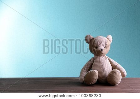 Teddy bear on blue background