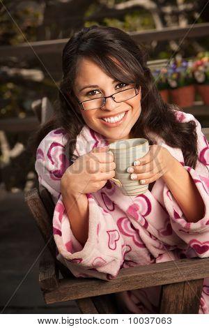 Pretty Hispanic Woman In Bathrobe With Tea Or Coffee