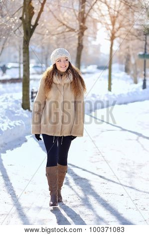 Emotive Portrait Of A Fashionable Model In White Coat And Beret Standing At The Winter Seaside. Sunn