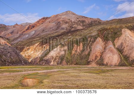 Pink and green rhyolite mountains surround the valley.  Summer morning in the National Park Landmannalaugar, Iceland