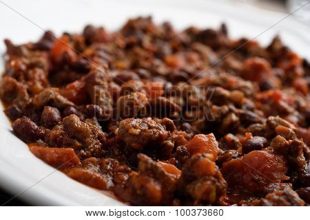 Closeup view of chili con carne in a bowl. Selective focus