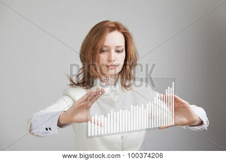 young businesswoman working with interactive graph