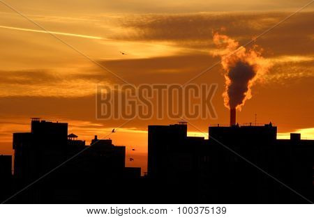 Urban industrial building on background of dawn
