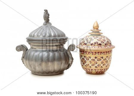 Old metal pot on a white background