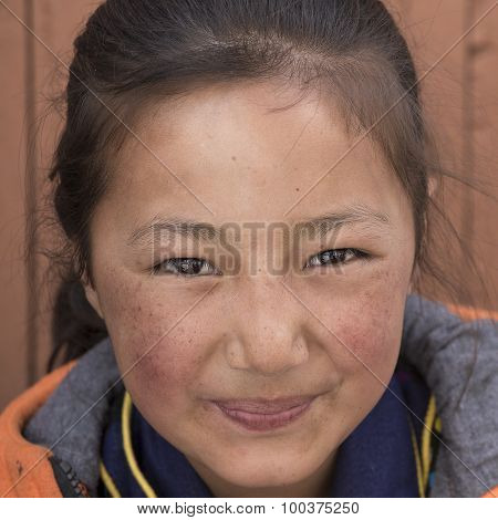 Portrait Tibetan Buddhist Young Girl In Hemis Monastery, Ladakh, North India