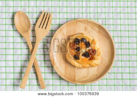 Danish Custard With Mixed Dried Fruit On Wooden Dish