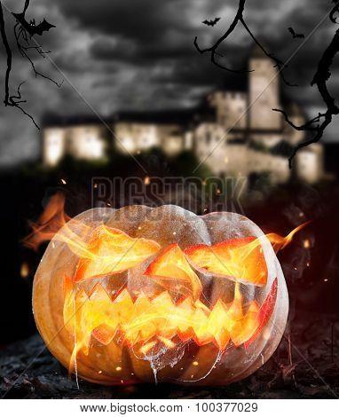 Burning halloween pumpkin on leaves. Castle on background