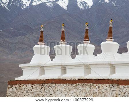 Buddhist Stupa And Himalayas Mountains . Shey Palace In Ladakh, India