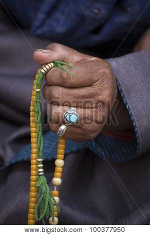 Old Tibetan Woman Holding Buddhist Rosary, Ladakh, India