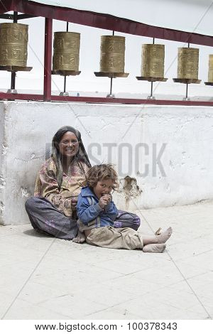 Indian Poor Woman With Children Begs For Money From A Passerby On The Street In Leh, India
