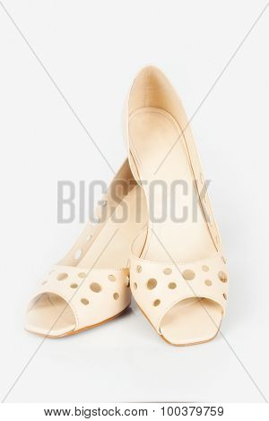 beautiful beige shoes isolated on white