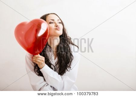 attractive girl with a red heart in the hands