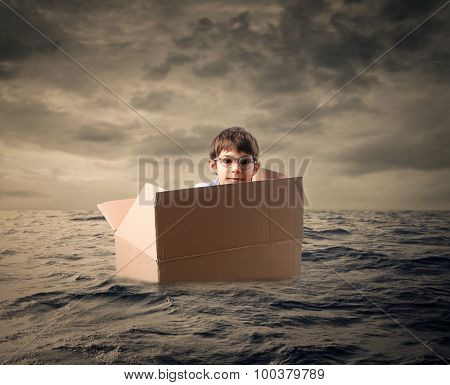Young boy lost in the middle of the sea