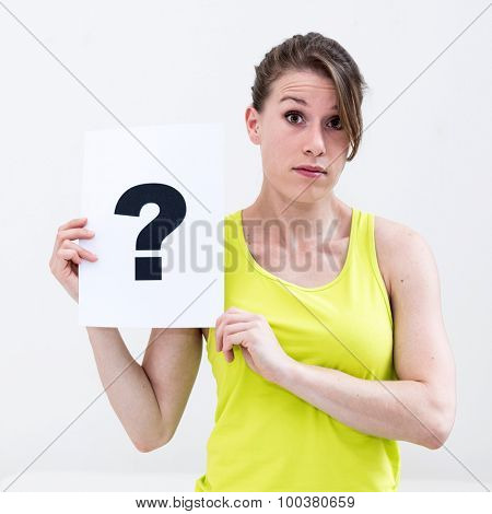 portrait young woman with board question mark sign